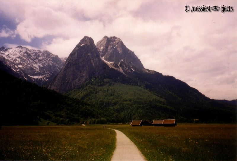 Bike Road through a meadow to the Zugspitze, the Highest Alp in Germany