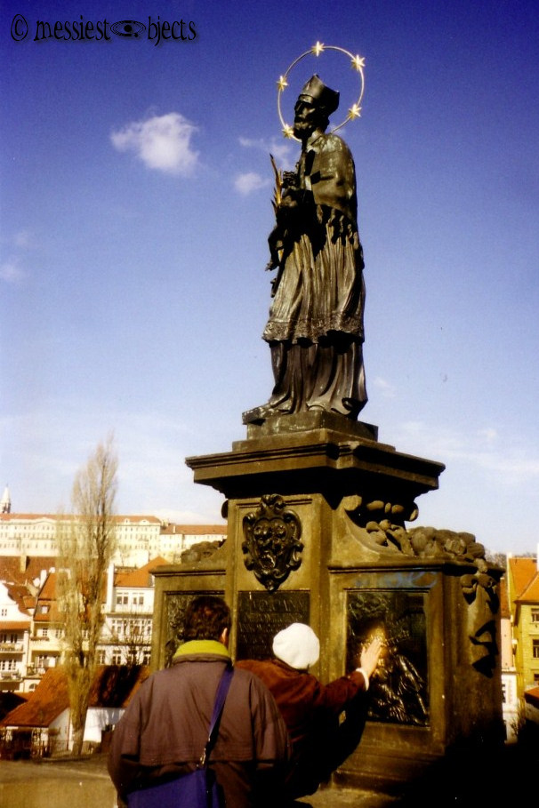 Karlovy Most (Charles Bridge) Statue. People Touch it for good luck